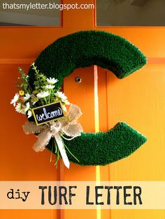 Craft: big turf letter Construct a 3-dimensional letter from cardboard, cover with turf and add a floral decoration for some fun Spring front door decor: Personalized to match our last name of course: Here's how to make the big turf letter: 1. Cut 2 matching letter shapes from cardboard and 2″ wide long strips: 2.... Read more