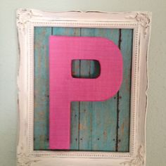 Mod podge wood paper on cardboard I left over, bought a P from hobby lobby mod podged it with pink lien paper. Found a old frame that had been painted!! Total cost under $4.00!!! Made for my daughter Paytons room.