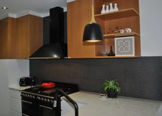 Timber veneer, tile splash back, stone bench top, polyurethane painted base cabinets