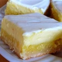 Cheesecake Lemon Bars ~ A light lemony cheesecake dessert that makes two layers, one lemony layer, and another cheesecake layer. You'll be coming back for more!,,