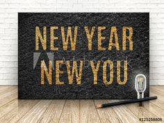 Inspiration quote,New year new you word with lightbulb and penci