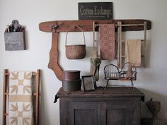 Use small ladders on pegs to hang linens