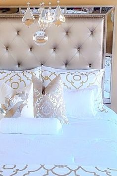 Glam bedroom inspiration! Pretty gold detailed bedding, with metallic accent pillows adds to this luxurious bedroom decor!