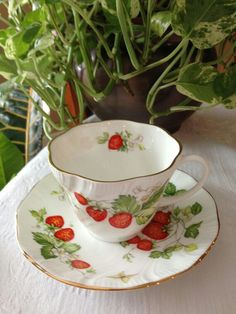 This is a beautiful teacup and saucer set!   It was Made in England by the Rosina China Co. Ltd  This is the Queen's Virginia Strawberry Pattern.   Both the cup and saucer have a scalloped edge, and are trimmed in gold. The strawberries are a vivid shade of red, and they almost look...