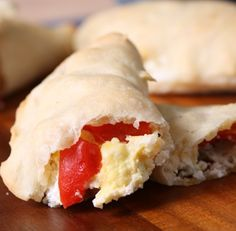 These breakfast pockets might look intimidating, but looks can be deceiving. We promise that you are more than capable of making this dough, tossing ingredients inside, sealing the edges, and popping 'em in the oven. We also promise that the feeling of opening the oven to your delicious creation is guaranteed to be more rewarding than popping open a microwave.