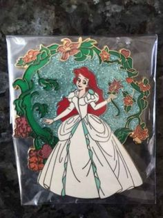 Extremely Rare Ariel Wedding Dress Pin, $1,000 | 18 Disney princess products every hardcore Disney fan needs