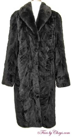 "SOLD! Black Sheared Mink Coat #BSM744; Excellent Condition; Size range: 10 - 14 Misses or Tall. This is an amazing genuine dyed black sheared mink sections fur coat. It has a Gentry's Furriers label and features a full-pelt ranch mink large shawl collar, straight sleeves and generous 11"" sleeve openings. The sheared mink fur is very silky soft and lightweight. Your purchase will be accompanied by a copy of a recent appraisal showing the present retail value to be $6,800. It is Luxurious!"