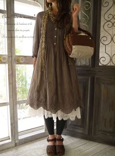 Mori, casual: Brown dress with buttons and details. Off white, lace underskirt. Black leggins. Dark brown, leather shoes.