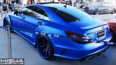 Excellent version of this Matte Blue Mercedes CLS 550 featuring a Misha Designs widebody kit and Forgiato Wheels on display at the Mercedes Cls550, Black Mercedes Benz, Mercedes Benz C300, Mercedes Benz Models, Best Luxury Cars, Luxury Suv, Sport Truck, Sport Cars, Mercedez Benz