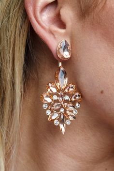 Our favorite new trend is the jacket earring. This unique piece of jewelry has a separate backing that can be paired with any stud front for a bit of an elegant touch to any look.