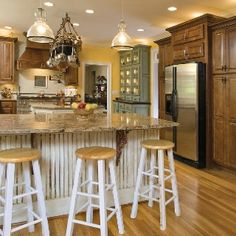 Love the marble top and dark wood cabinets
