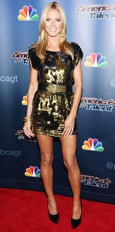 Heidi Klum shimmered on the America's Got Talent post-show red carpet in a belted black-and-gold sequined Zadig & Voltaire mini, complete with gilded accessories and patent black pumps.