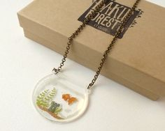 2D Goldfish in a Bowl Terrarium Necklace on Clear Acrylic by BakuForestStudios on Etsy https://www.etsy.com/listing/211708400/2d-goldfish-in-a-bowl-terrarium-necklace