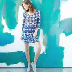 Don't pack away that sundress yet, a pair of booties will make it a perfect multi-season piece.