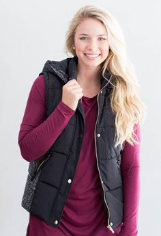 "This vest is so versatile as it features a removable hood! This is a great quality vest that can go over so much. Don't miss out on this beauty. 100% Polyester Model is 5'4"" size 4 in a small. Measure"