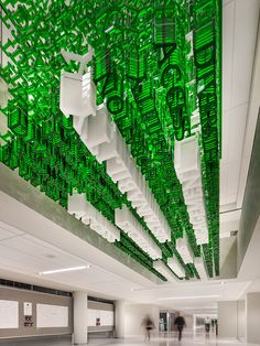 Three separate offices (Dallas for architecture, Atlanta for interiors, and Chicago for branding and graphics) collaborated to refresh the University of North Texas Student Center, where acrylic letters that compose the university's values sta