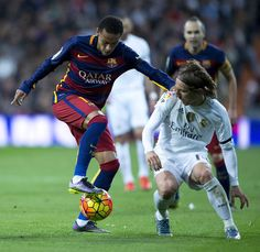 Neymar JR. (2ndR) of FC Barcelona competes for the ball with Luka Modric (R) of Real Madrid CF during the La Liga match between Real Madrid CF and FC Barcelona at Estadio Santiago Bernabeu on November 21, 2015 in Madrid, Spain.