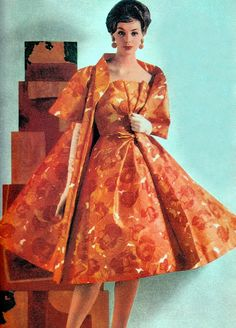 Sylvia is wearing a double helping of orange flowers in a dress & coat with short full sleeves, typical of Scaasi's floral displays for Spring. 1958. From Scaasi A Cut Above. (minkshmink)
