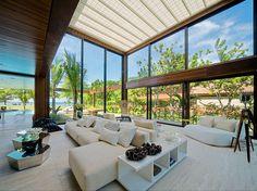 Living Room design from the Exotic and Modern Laranjeiras House in Rio de Janeiro, Brazil designed by Studio Fernando Marques | #InteriorDesign #Interiors #LivingRoom |