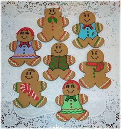 Gingerbread Boys and Girls - Gingerbread cookies decorated in RI. I decorate the vests and dresses in a ton of different colors and designs. Gingerbread Man Decorations, Gingerbread Crafts, Christmas Gingerbread Men, Gingerbread Man Cookies, Christmas Sugar Cookies, Gingerbread Houses, Christmas Treats, Christmas Baking, Christmas Decor