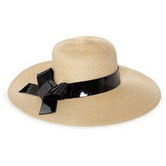 "A playful ode to fun in the sun this lacquered straw hat is bedecked with a pair of tromp l'eoil cat-eye sunglasses. Lacquered straw. 23"" Circumference; 4.25"" …"