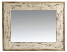 Rustic wood mirror with heavily-distressed white painted finish. Natural hardwood (alder) frame is surrounded by a reclaimed wood (barnwood) end cap. Mirror has been hand-distressed to mimic the look of rough sawn lumber, but grinder marks are hand-applied. Handmade in the USA by artisans who are expert in working with rustic and salvaged wood. Hangs horizontally or vertically.