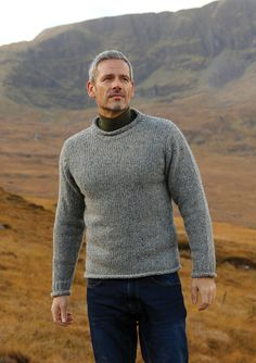 This Mens Roll neck Aran fishermans sweater with rolled cuffs and hems was once the fisher mans friend, now it inspires looks of heritage. The type of sweater you can dress up or down for any occasion. Smart or casual, you will love wearing this one. This Sweater is a slim fit but if your looking for a loose look then order a Size up.