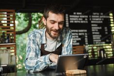 Portrait of smiling barista man using tablet computer while work photo by vadymvdrobot on Envato Elements Male Swimmers, Black Press, Crop Photo, Crop Image, Tablet Computer, Barista, Mood, Smile, Stock Photos
