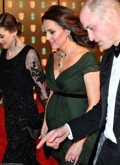 Bump in the night: Seen outside London's Royal Albert Hall, Kate was coping with a chill i...