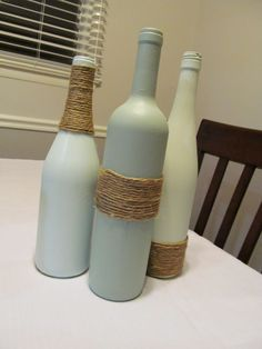 Wine bottle project, can paint them the colors of the wedding, love the twine, then put something in the bottles, flowers or something. Would make good center pieces!