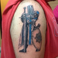 knight tattoo by Travis at Tattoos Forever, for an appointment call 850-244-5117