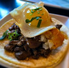 "#MyDayinLA - What's for lunch? How about this ""try before you die"" MP3 taco from Komodo in Venice.  Top sirloin steak / sunny side up egg / tator tots / garlic aioli / cilantro"
