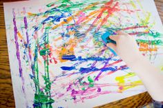 Car painting.  Tried and true painting activity that keeps toddlers and big kids alike very happy.