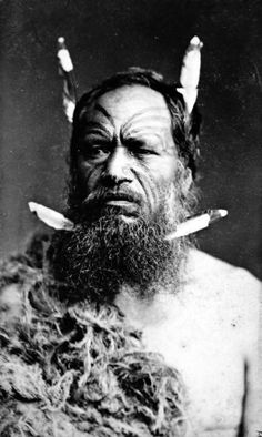 This photograph of an unidentified Maori man with a moko (facial tattoo) was taken in 1880.     Some Christian missionaries disapproved of moko, arguing that they were a heathen practice, so some Maori men let their facial hair grow to cover their tattoos.     Friggin missionaries.
