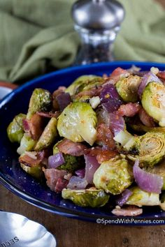 Garlic Roasted Bacon Brussels Sprouts merge the goodness of tender Brussels sprouts along with the indulgence of crisp smoky bacon and loads of sweet garlic. This easy roasted veggie dish will become a staple side at your dinner table!