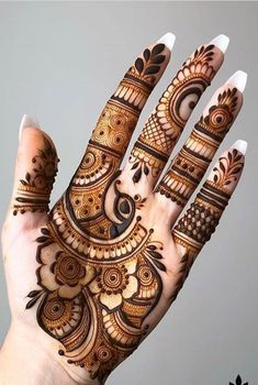 Henna tattoo designs are for tattoo lovers who don't wish to go under the needles. Check out some breathtaking henna tattoos for wrists, arms, and legs here. Henna Hand Designs, Mehndi Designs Finger, Palm Mehndi Design, Mehndi Designs Book, Modern Henna Designs, Mehndi Designs 2018, Mehndi Designs For Girls, Mehndi Designs For Beginners, Mehndi Design Pictures