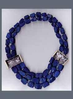 N-2491 Afghan hammered Lapis beads with two mirror cut Amethysts,18K yellow Gold