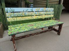Muddy Puddle Crafts organised a school community project and painted this bench with DecoArt paints.
