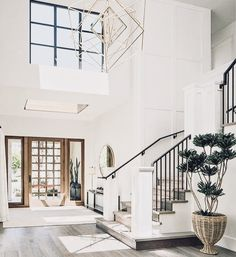 Open Entryway, high ceilings, modern entryway, modern home ideas, open concept, big entryway