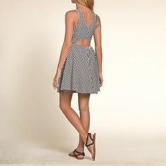 Girls Open Back Skater Dress | Lightweight and drapey with structural stitching, a high neckline and wrap open back detailing | HollisterCo.com