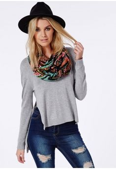Mix up your prints with this multicoloured snood finished with cute pom pom trim, perfect for adding a bold edge to your look.