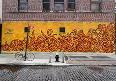 "Another example of Tunisian-French Street Artist eL Seed's ""calligraffiti"" – traditional Arabic calligraphy incorporated into graffiti. (Chrystie Street, NYC)"