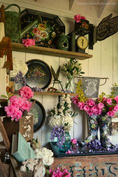 In the Potting Shed: Shelves with Blooming Wellies, Tole Trays and Flowers | homeiswheretheboatis.net #garden #spring