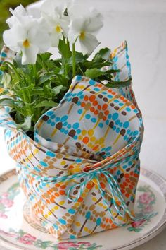 Adorable Tutorial! Wrap up potted plants in vintage hankies for May Day gifts.