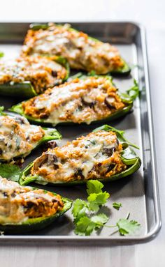 Queso Stuffed Poblanos recipe - these are the BEST stuffed peppers! Adaptable to whatever veggies or protein you have on hand. Easy vegetarian YUMS! pinchofyum.com