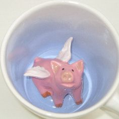 Flying Pig Surprise Mug by SpademanPottery on Etsy. $27.00 USD, via Etsy. Adorable, but how would you clean this?