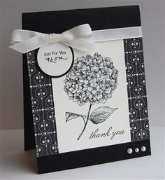 Love Letter designer paper adds just the right touch behind the Because I Care stamped flower.  Basic black with a white bow and pearls.  Handmade thank you card
