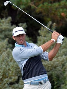 US golfer Dustin Johnson watches his iron shot from the second tee ...