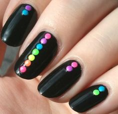 Matte black nails with neon nail art studs