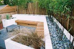 Black limestone paving, hardwood bench & bamboo
